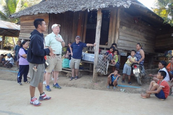 Photo above shows Missionary Blake along with Miss Belle and her husband, sharing the love of God in the village of Mowah Kee, Thailand.