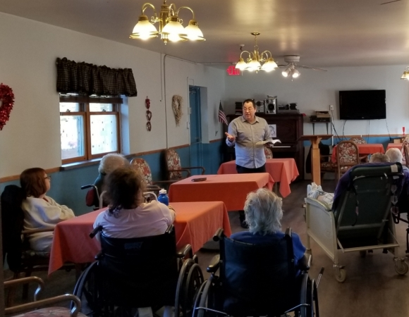 FG Minister John Reviello holding services at a nursing home.